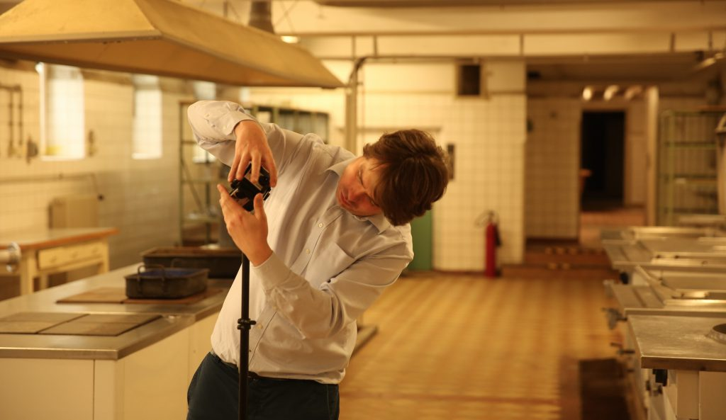 "(VR director Martin Heller shooting 360° Video for ""See The Signs"" in the former prison. Photo by Michael Ginsburg / Gedenkstätte Berlin Hohenschönhausen)"